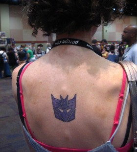 Transformers logo back tattoo
