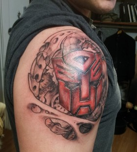 Transformers logo shoulder tattoo