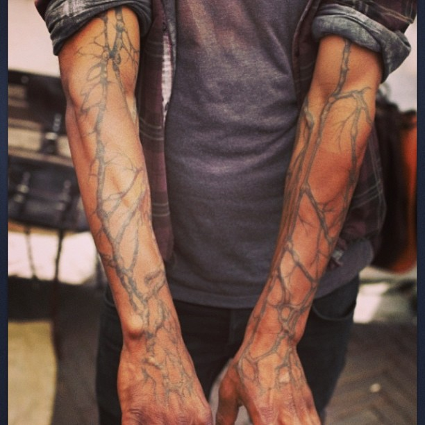 Tree branch full arm tattoo