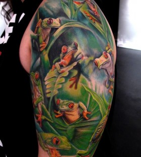Tree frogs arm tattoo