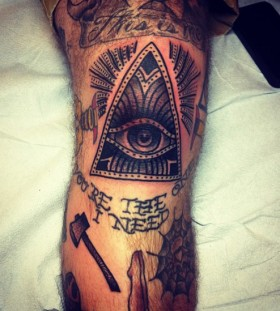 Triangle eye knee tattoo