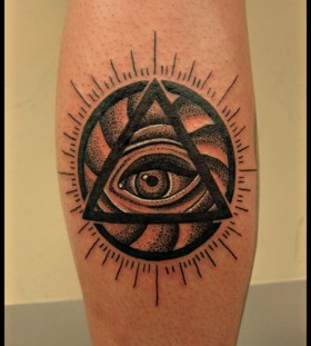 Triangle eye leg tattoo