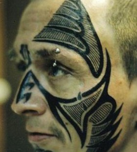 Tribal face tattoo