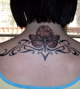 Tribal moth back tattoo
