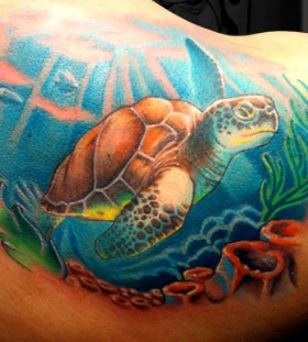Turtle in the ocean tattoo