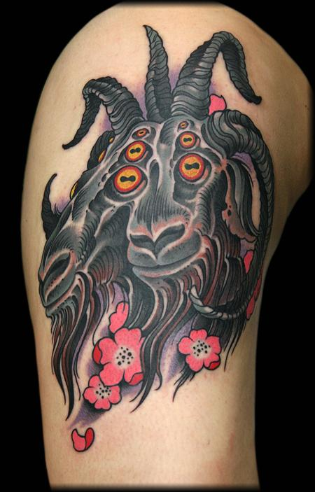 Two faced goat tattoo