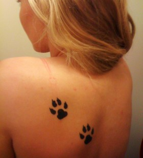 Two paws back tattoo