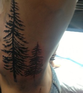 Two pine trees side tattoo