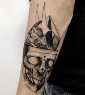 Two skulls tattoo by Michele Zingales