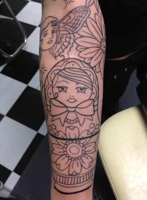 Uncoloured matryoshka arm tattoo