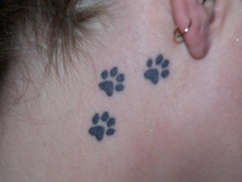Upper neck paw tattoo