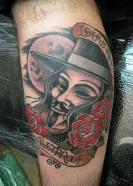 V for vendetta theme leg tattoo