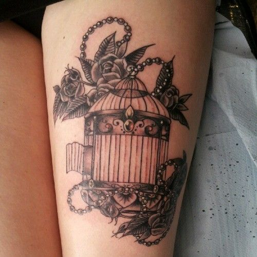 Vintage birdcage and flowers tattoo