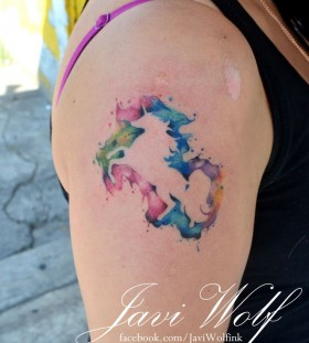 Watercolor style shoulder unicorn tattoo
