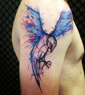 Watercolour bird arm tattoo by Tyago Compiani