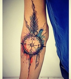 Watercolour compass arm tattoo by Tyago Compiani