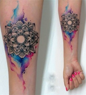 Watercolour lotus flower tattoo with bleed
