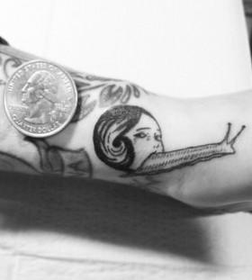 Weird snail arm tattoo