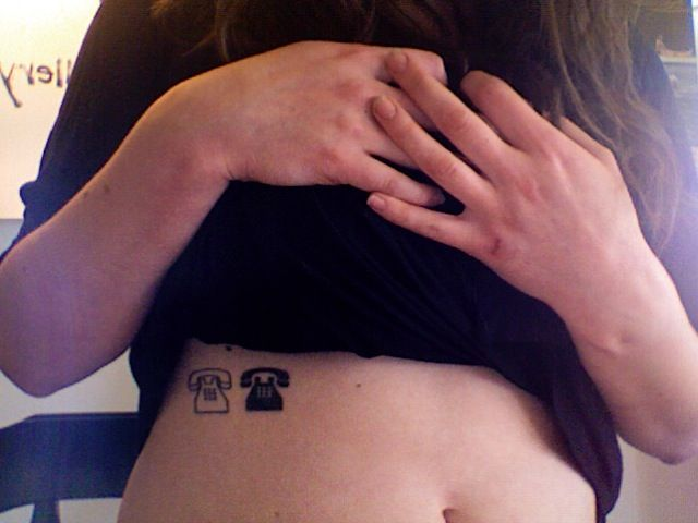 White and black woman's telephone tattoo