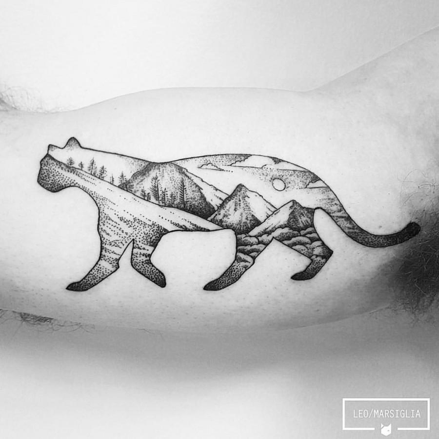 wild cat scenery tattoo by leo marsiglia