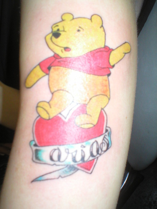 Winnie the pooh and heart tattoo