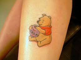 Winnie the pooh and pot of honey tattoo
