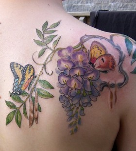 Wisteria and butterflies tattoo by Esther Garcia
