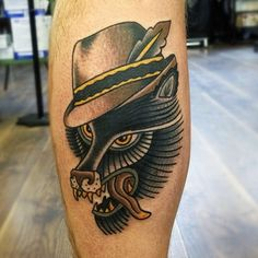 Wolf with a hat tattoo by Matt Cooley
