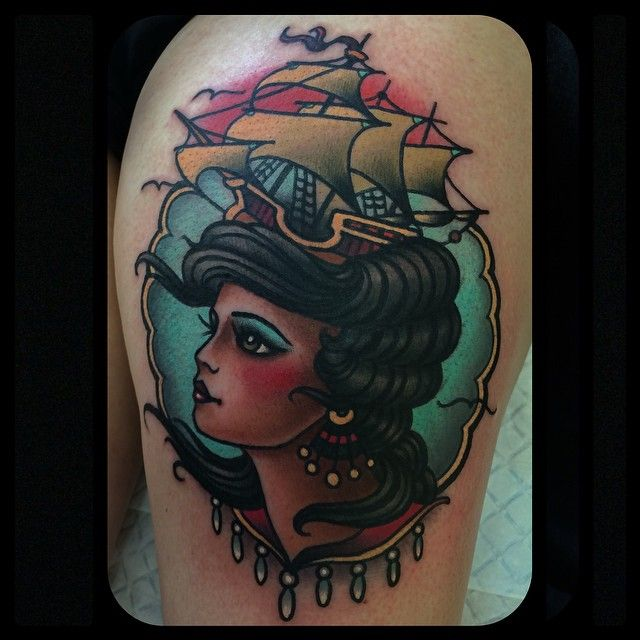 Woman and boat tattoo by W. T. Norbert