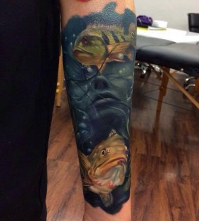 Woman and fish tattoo by Kyle Cotterman