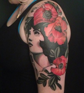 Woman and flowers tattoo by Amanda Leadman