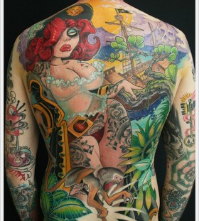 Woman and jungle theme back tattoo