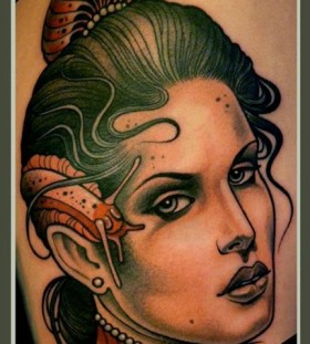 Woman and snail tattoo by Lars Uwe Jensen