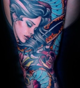 Woman and snake tattoo by W. T. Norbert