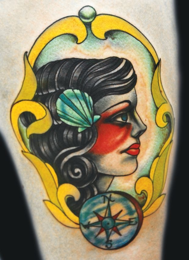 Woman frame tattoo by Eva Huber