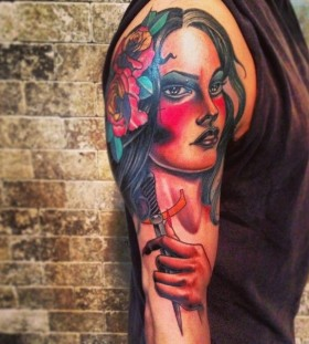 Woman with a knife tattoo by Jon Mesa