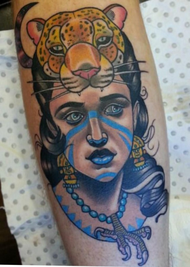 Woman with a tiger's head tattoo by Drew Shallis