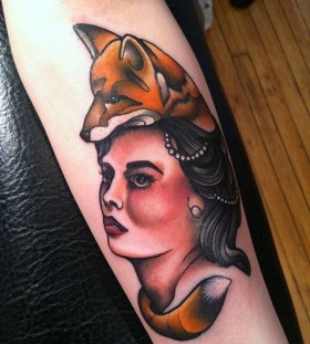 Woman with fox head tattoo by Amanda Leadman