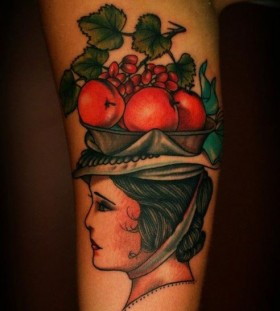 Woman with fruit basket tattoo by Charley Gerardin