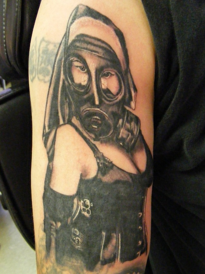 Woman with gas mask arm tattoo
