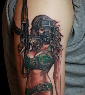 Woman with gun and gas mask tattoo