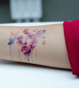 Woman's face and watercolor butterfly tattoo