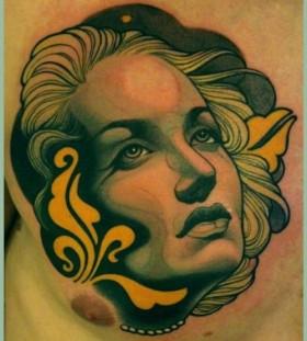Woman's face tattoo by Lars Uwe Jensen
