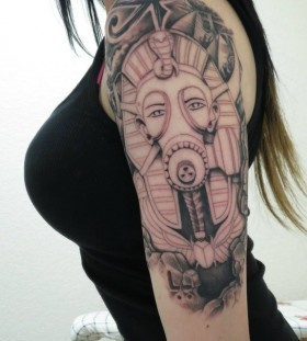 Women's shoulder egyptian eye tattoo