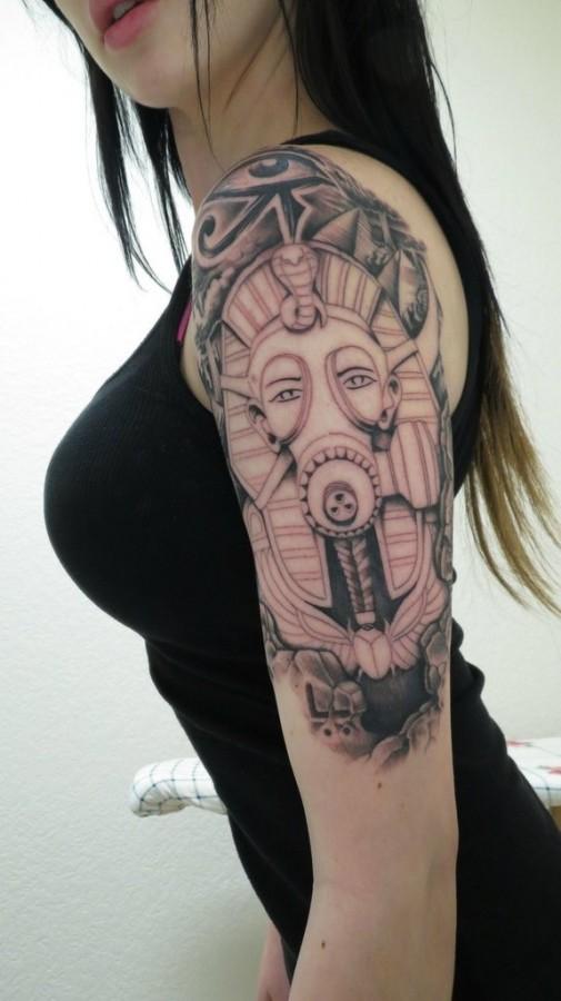 Women's shoulder egyptian eye tattoo