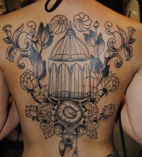 Wonderful birdcage back tattoo