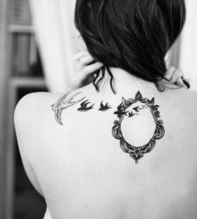 Wonderful frame and birds tattoo