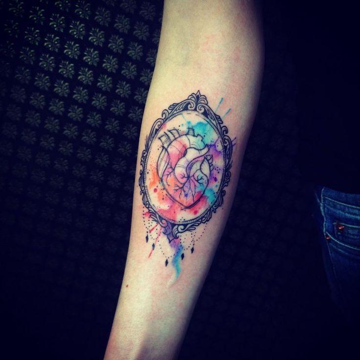 Wonderful watercolour frame tattoo by Tyago Compiani