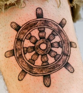 Wooden ship's wheel tattoo