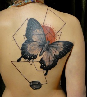 Xoil butterfly back tattoo